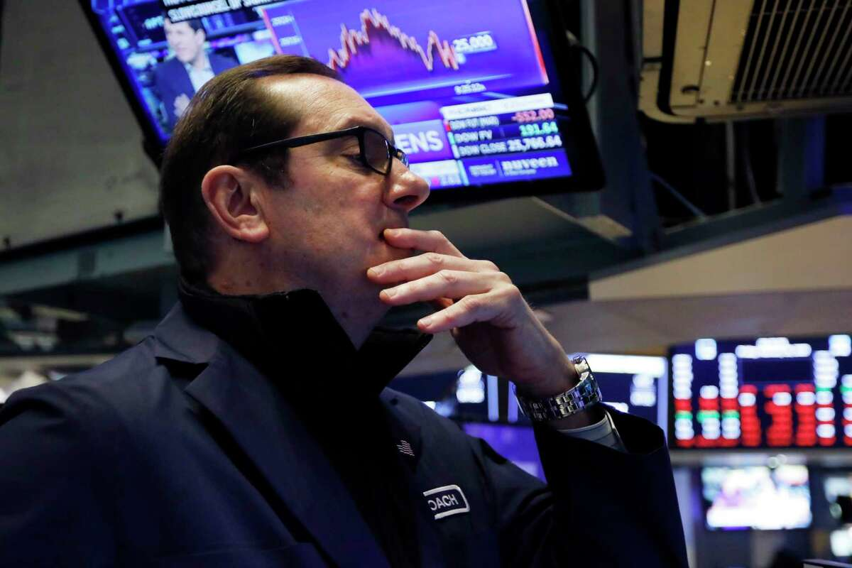 William O'Keefe works on the floor of the New York Stock Exchange, Friday, Feb. 28, 2020. Stocks are opening sharply lower on Wall Street, putting the market on track for its worst week since October 2008 during the global financial crisis. (AP Photo/Richard Drew)