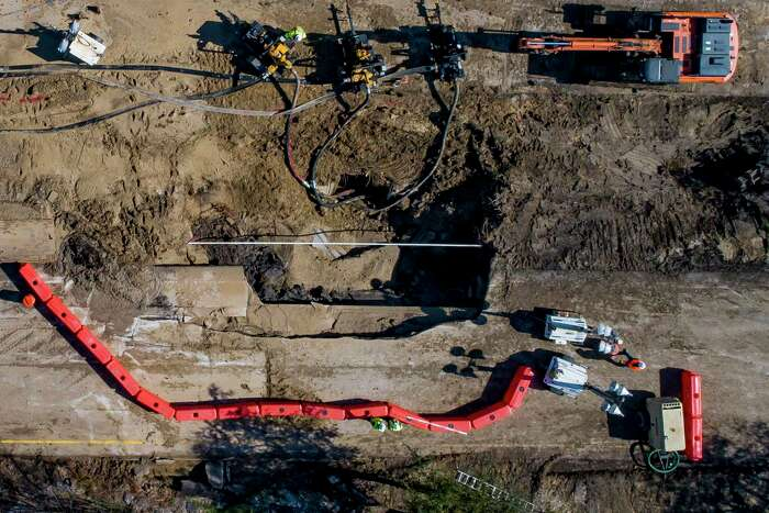 Work is ongoing at the site of a water main break, Friday, Feb. 28, 2020, along Clinton Drive between Pennsylvania and North Carolina streets in Houston. When the break occurred Thursday afternoon, 610 East had to be shut down in both directions.