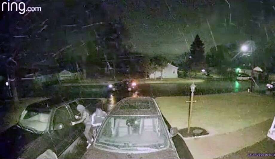 A screenshot of the video, showing the two suspects as they approached the vehicles in the Derby, Conn., driveway on Thursday, Feb. 27, 2020, just after the motion-sensor light switched on. Photo: Contributed Photo / Derby Police Department