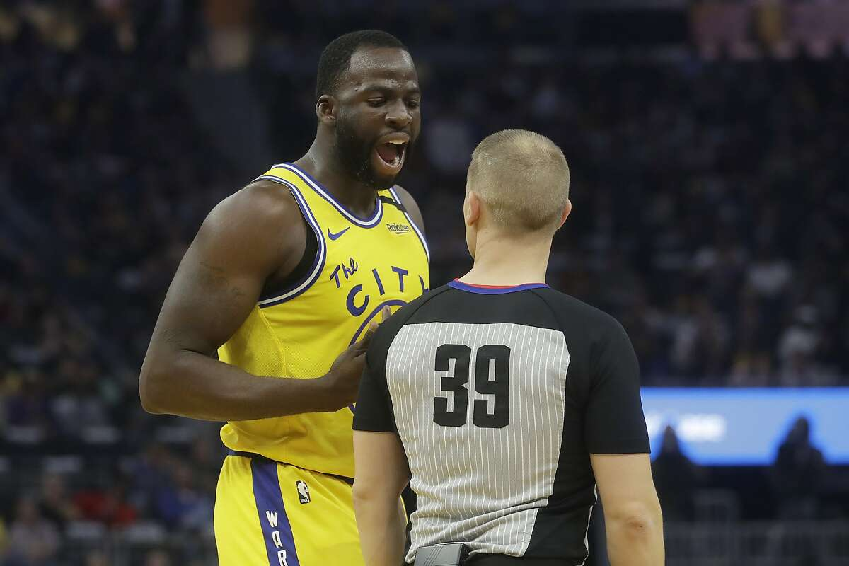 Golden State Warriors forward Draymond Green, left, argues with referee Tyler Ford during the first half of an NBA basketball game between the Warriors and the Los Angeles Lakers in San Francisco, Thursday, Feb. 27, 2020. (AP Photo/Jeff Chiu)