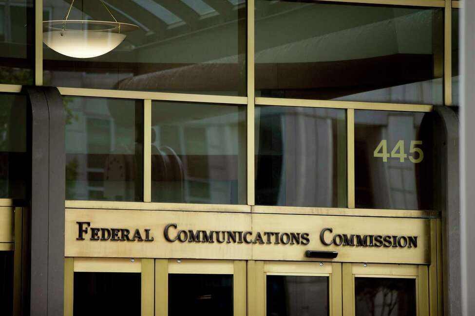 FILE - This June 19, 2015, file photo, shows the Federal Communications Commission building in Washington. The Federal Communications Commission on Friday, Feb. 28, 2020, is proposing about $200 million in fines combined for the four major U.S. phone companies for improperly disclosing customers' real-time location. Location data makes it possible to identify the whereabouts of nearly any phone in the U.S.A (AP Photo/Andrew Harnik, File)