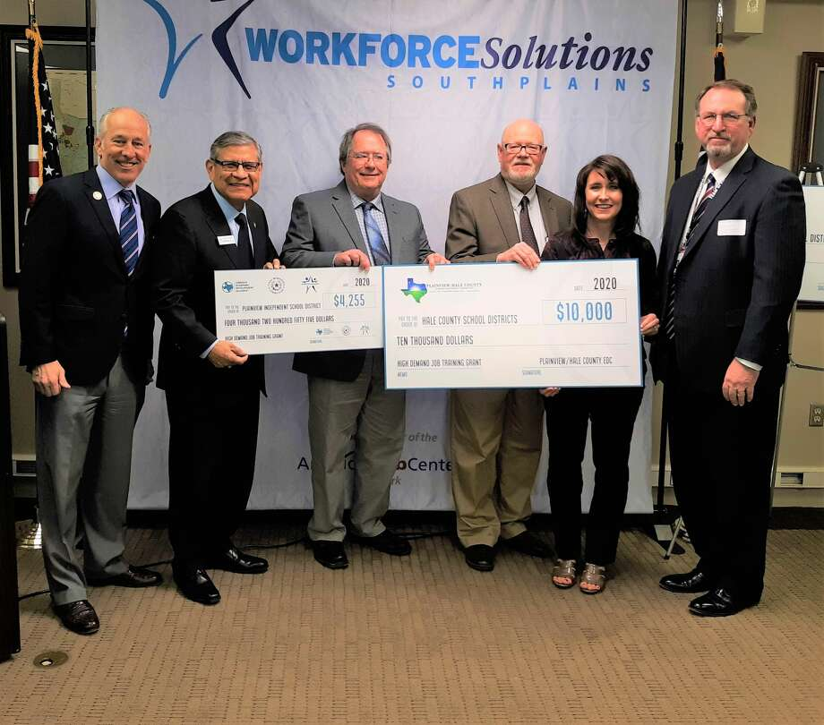 Officials with Plainview ISD and the Plainview Hale County Economic Development Corporation accept checks for Plainview ISD's CTE programs from Workforce Solutions South Plains. Pictured (L-R): Lubbock Mayor Dan Pope, WSSP CEO Martin Aguirre, WSSP Board Chairman Chuck Smith, Plainview-Hale County EDC Executive Director Mike Fox, PISD director of secondary teaching and learning Robin Straley, and Brant Reagan, Plainview High School principal Photo: Courtesy Photo/Workforce Solutions South Plains