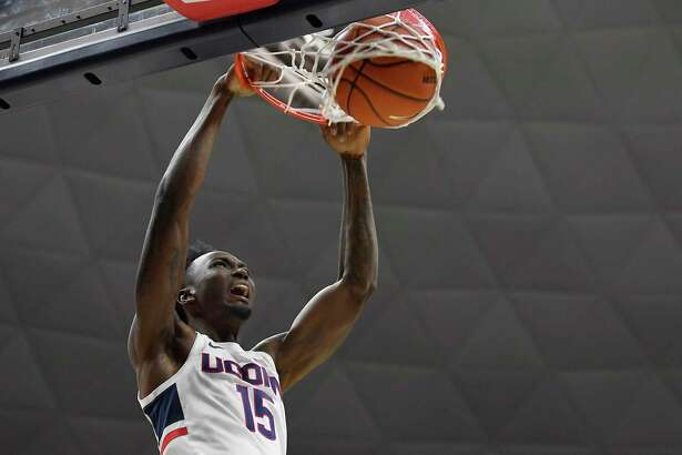 Connecticut's Sidney Wilson dunks in the second half of an NCAA college basketball game, Wednesday, Dec. 4, 2019, in Storrs, Conn. (AP Photo/Jessica Hill)