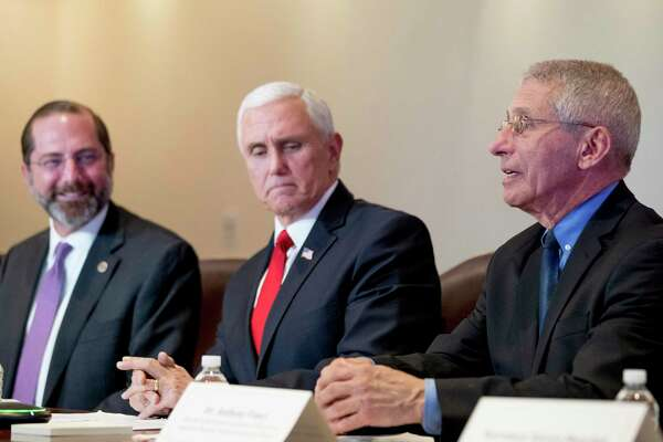 National Institute for Allergy and Infectious Diseases Director Dr. Anthony Fauci, right, accompanied by Vice President Mike Pence, center, and Health and Human Services Secretary Alex Azar, left, speaks during a Coronavirus Task Force Meeting at the Department of Health and Human Services, Thursday, Feb. 27, 2020, in Washington. (AP Photo/Andrew Harnik)