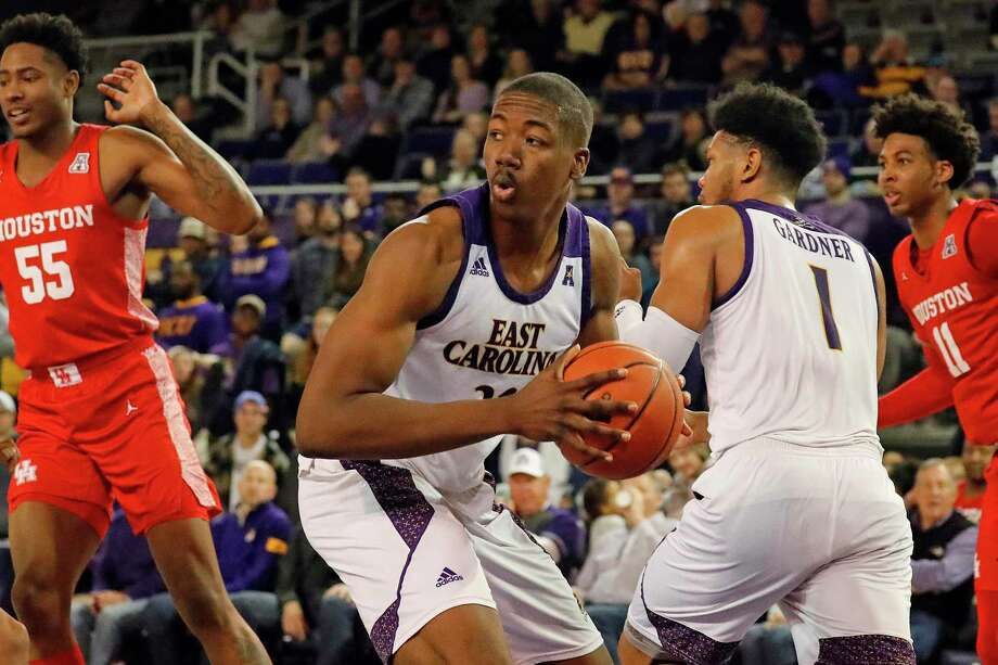 East Carolina's Charles Coleman (32) grabs a rebound against Houston during the second half of an NCAA college basketball game in Greenville, N.C., Wednesday, Jan. 29, 2020. (AP Photo/Karl B DeBlaker) Photo: Karl B DeBlaker / Associated Press / Copyright 2020 The Associated Press. All rights reserved