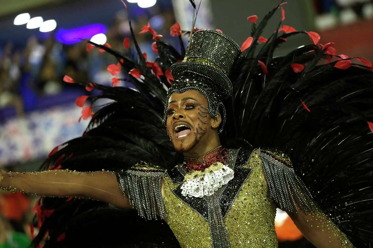 A performer from the Salgueiro samba school parades during Carnival celebrations at the Sambadrome in Rio de Janeiro, Brazil, Tuesday, Feb. 25, 2020. (AP Photo/Silvia Izquierdo)