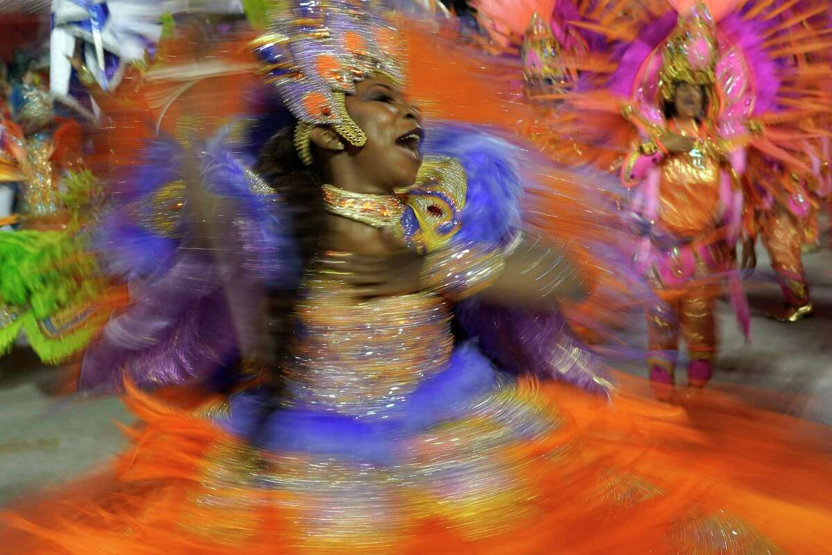 A performer from the Beija Flor samba school parades during Carnival celebrations at the Sambadrome in Rio de Janeiro, Brazil, Tuesday, Feb. 25, 2020. (AP Photo/Leo Correa)