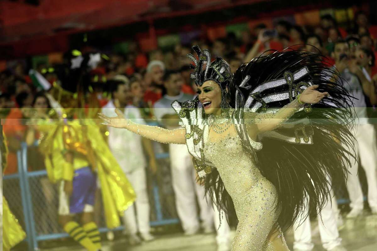 Performer from the Mocidade samba school parades during Carnival celebrations at the Sambadrome in Rio de Janeiro, Brazil, Tuesday, Feb. 25, 2020. (AP Photo/Silvia Izquierdo)