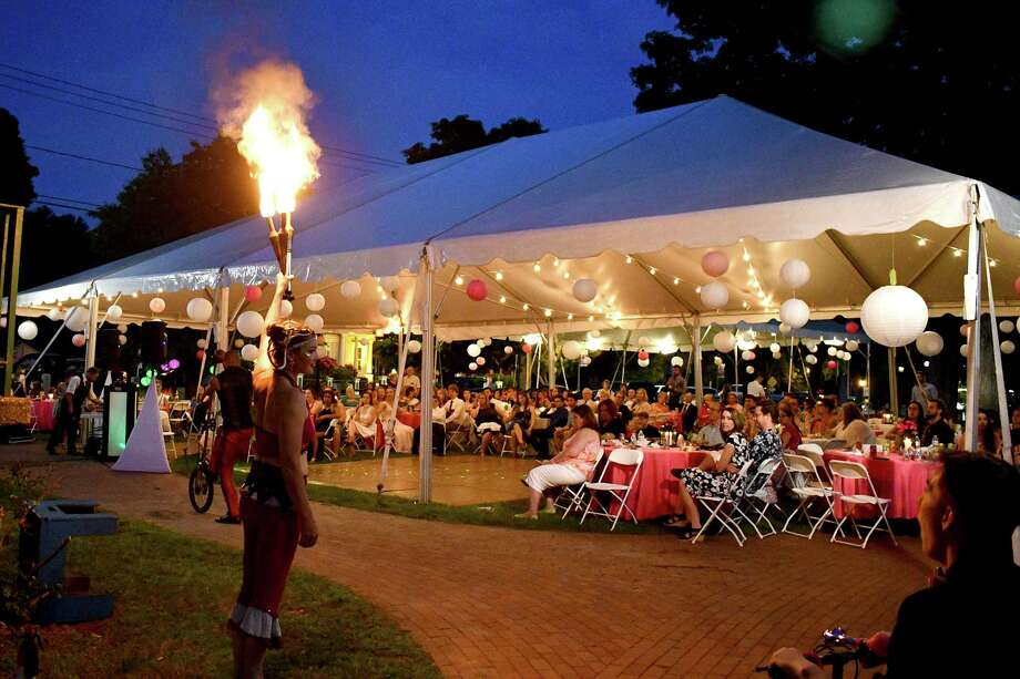 The annual Laurel Festival in Winsted begins with the annual Laurel Ball in East End Park. Above, guests at the 2019 ball. This year's festival will be held June 6-7. Photo: Lara Green-Kazlauskas / For Hearst Connecticut Media /