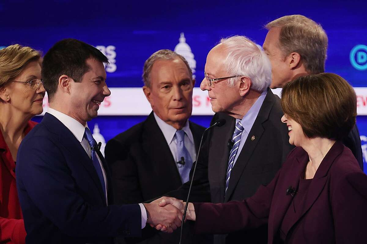 CHARLESTON, SOUTH CAROLINA - FEBRUARY 25: Democratic presidential candidates Sen. Elizabeth Warren (D-MA), former South Bend, Indiana Mayor Pete Buttigieg, former New York City Mayor Mike Bloomberg, Sen. Bernie Sanders (I-VT), Sen. Amy Klobuchar (D-MN), and Tom Steyer speak after the Democratic presidential primary debate at the Charleston Gaillard Center on February 25, 2020 in Charleston, South Carolina. Seven candidates qualified for the debate, hosted by CBS News and Congressional Black Caucus Institute, ahead of South Carolinas primary in four days. (Photo by Win McNamee/Getty Images) *** BESTPIX ***