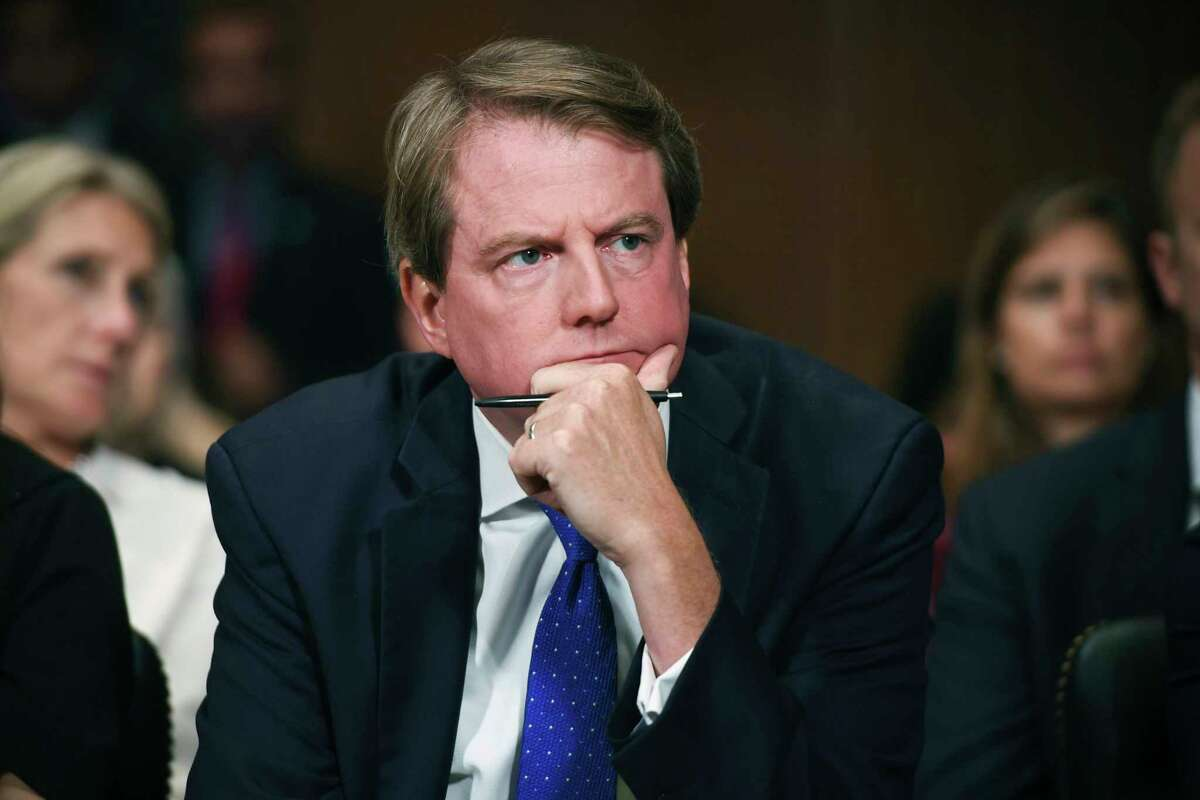 FILE - In this Sept. 27, 2018, file photo, then-White House counsel Don McGahn listens as Supreme court nominee Brett Kavanaugh testifies before the Senate Judiciary Committee on Capitol Hill in Washington. In a setback for Democrats in Congress, a federal appeals court has ruled that judges have no role to play in the subpoena fight between the House of Representatives and the Trump administration over the testimony of high-ranking officials. (Saul Loeb/Pool Photo via AP, File)