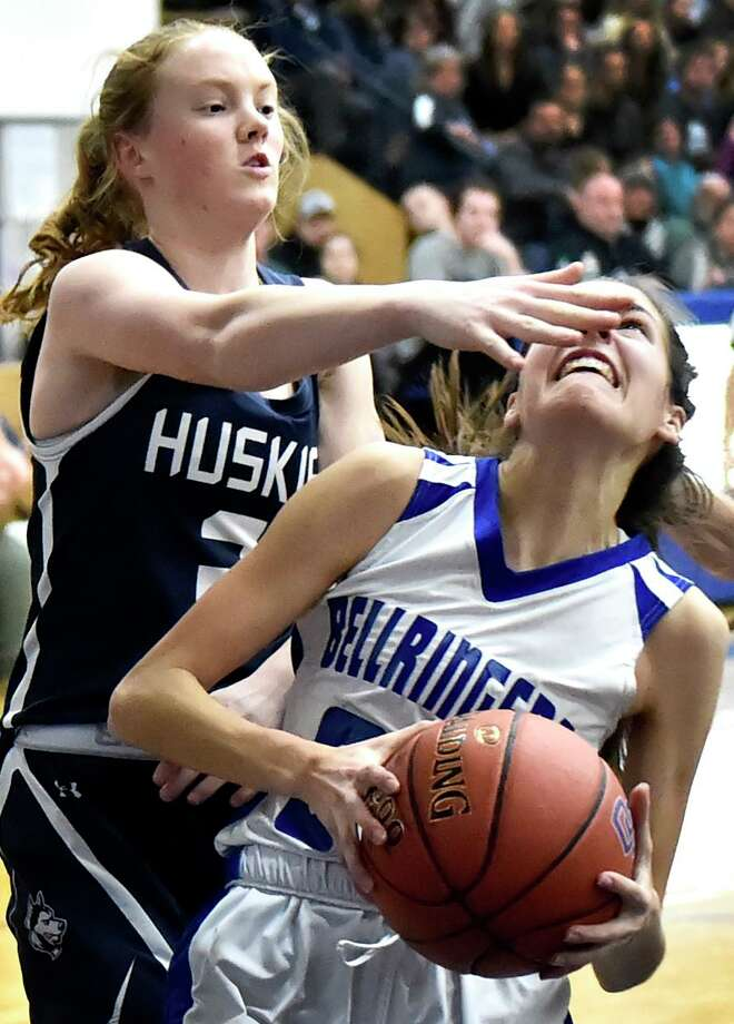 Old Saybrook, Connecticut - February 28, 2020: Katelyn Martin of Morgan H.S., left, tries to play defense against Danielle Adams of East Hampton H.S., right, in the second quarter of the Shoreline Conference girls basketball finals Friday evening at Old Saybrook High School. Photo: Peter Hvizdak / Hearst Connecticut Media / New Haven Register
