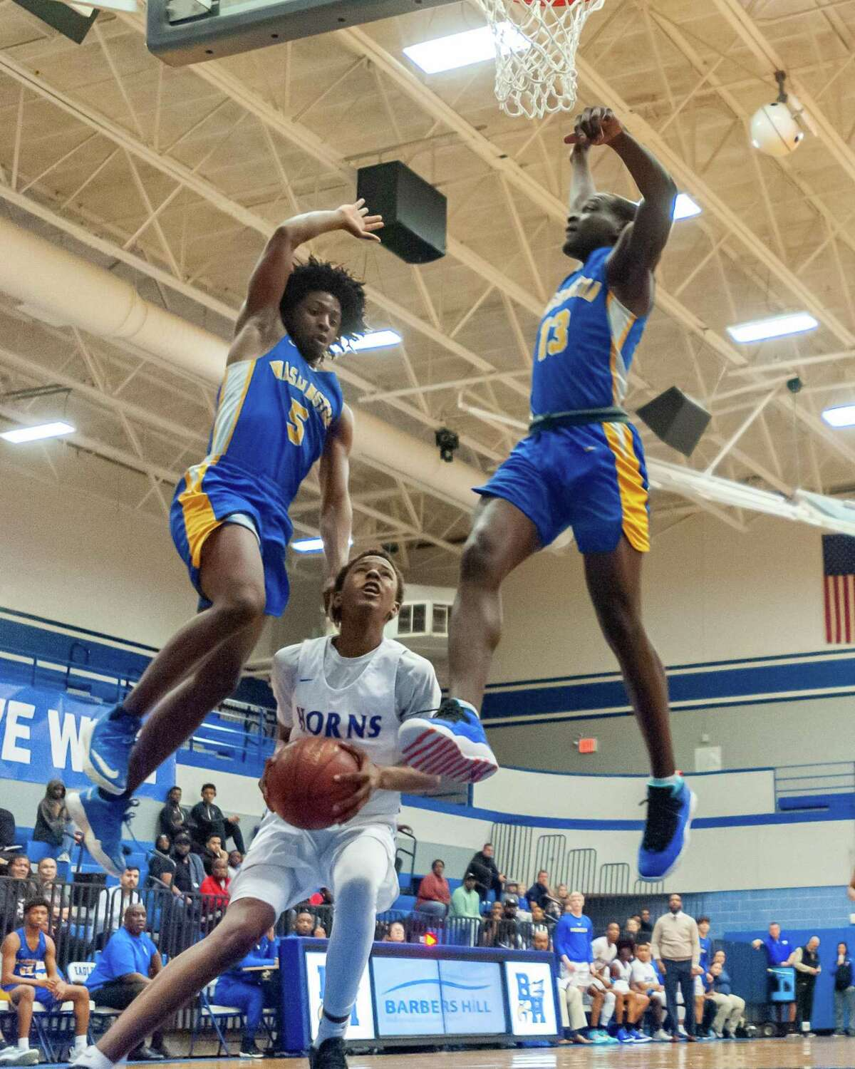 Robert Reed (12) waits for the traffic to clear to put up a layup in the first half as the Longhorns of Hamshire-Fannett went down to the Eagles of Booker T. Washington in the area round playoffs at Barbers Hill High School on Friday, February 28, 2020. Fran Ruchalski/The Enterprise