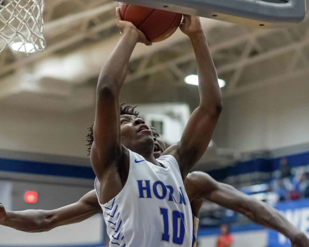 Davon Guillory (10) puts up a shot in the second half as the Longhorns of Hamshire-Fannett went down to the Eagles of Booker T. Washington in the area round playoffs at Barbers Hill High School on Friday, February 28, 2020. Fran Ruchalski/The Enterprise