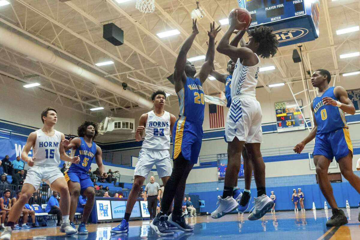 Tahji Edwards (21) puts up a shot in the first half as the Longhorns of Hamshire-Fannett went down to the Eagles of Booker T. Washington in the area round playoffs at Barbers Hill High School on Friday, February 28, 2020. Fran Ruchalski/The Enterprise