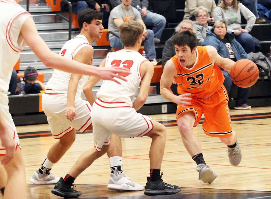 The Ubly boys basketball team picked up its 11th win of the season with a 43-29 victory over visiting Marlette on Friday night. Photo: Mark Birdsall/Huron Daily Tribune