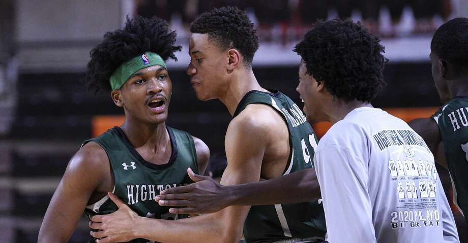Hightower guard Bryce Griggs, left, celebrates with teammates during a timeout during the second half of a high school basketball playoff game against Port Arthur Memorial, Friday, Feb. 28, 2020, in La Porte, TX. Photo: Eric Christian Smith/Contributor
