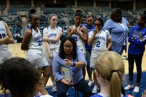Cy Creek Head Coach Jennifer Alexander talks to her team during a time out late in the fourth quarter of a Girls 6A Region III semifinal play-off game between the Cy Creek Cougars and the Summer Creek Bulldogs on Friday, February 28, 2020 at the Leonard Merrell Center, Katy, TX.