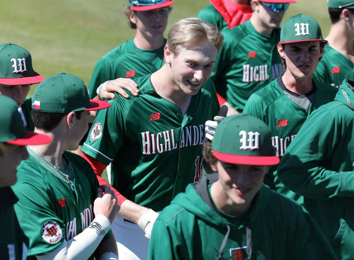 Justin Harris #16 of The Woodlands, center, reacts after hitting a solo home run to tie Kingwood 5-5 during the sixth inning of a non-district high school baseball game at Kingwood High School, Friday, Feb. 28, 2020, in Kingwood.