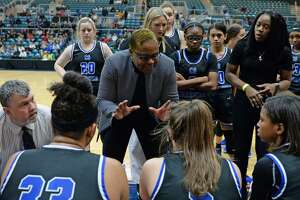Clear Springs Head Coach Pamela Crawford talks to her team during a time out late in the fourth quarter of a Girls 6A Region III semifinal play-off game between the Ridge Point Panthers and the Clear Springs Chargers on Friday, February 28, 2020 at the Leonard Merrell Center, Katy, TX.