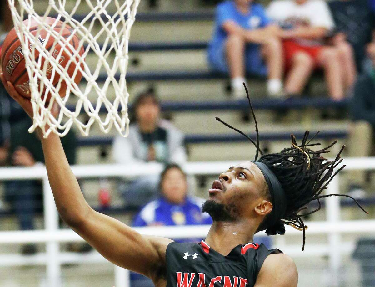 Wagner's Journee Phillips lays in a basket for two of his game-high 27 points on Friday at Taylor Field House. Phillips added eight points in the fourth quarter.