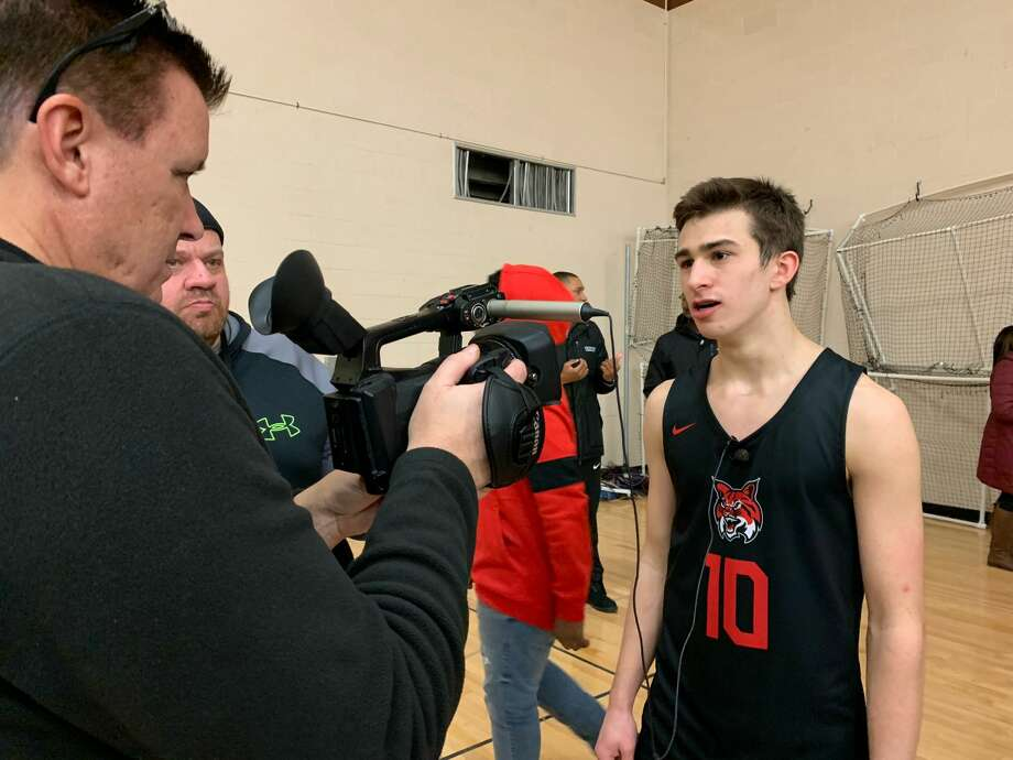 Grand Blanc's RJ Taylor is interviewed by the media following Friday's SVL championship victory over Mount Pleasant at Bay City Western High School. Photo: Fred Kelly/fred.kelly@mdn.net