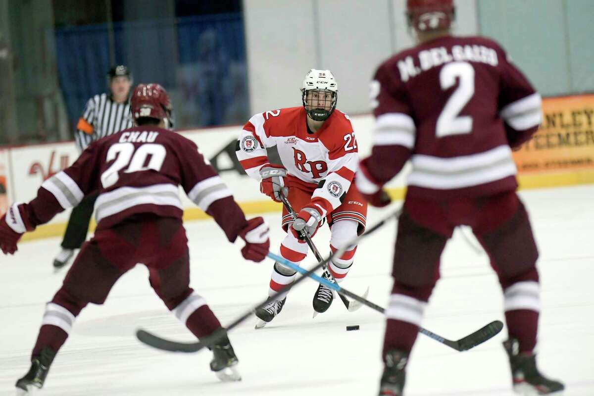 Rensselaer Polytechnic Institute forward Cory Babichuk (22) moves the puck against Massachusetts during the second period of an NCAA college hockey game Sunday, Dec. 29, 2019, in Troy, N.Y. (Hans Pennink / Special to the Times Union) ORG XMIT: 123019_rpi_HP105