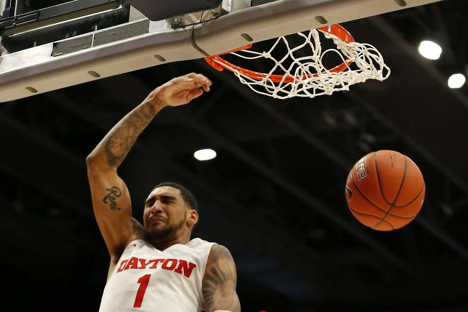 Dayton forward Obi Toppin dunks against Davidson during the second half Friday in Dayton, Ohio. Photo: Gary Landers / Associated Press