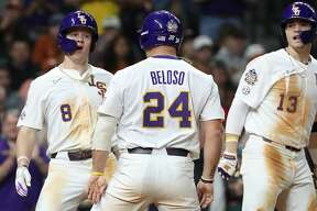 LSU right fielder Daniel Cabrera (8) celebrates with first baseman Cade Beloso (24), and designated hitter Saul Garza (13) after hitting a two-run home run during the sixth inning of the Shriners Hospitals for Children College Classic at Minute Maid Park on Friday, Feb. 28, 2020, in Houston.