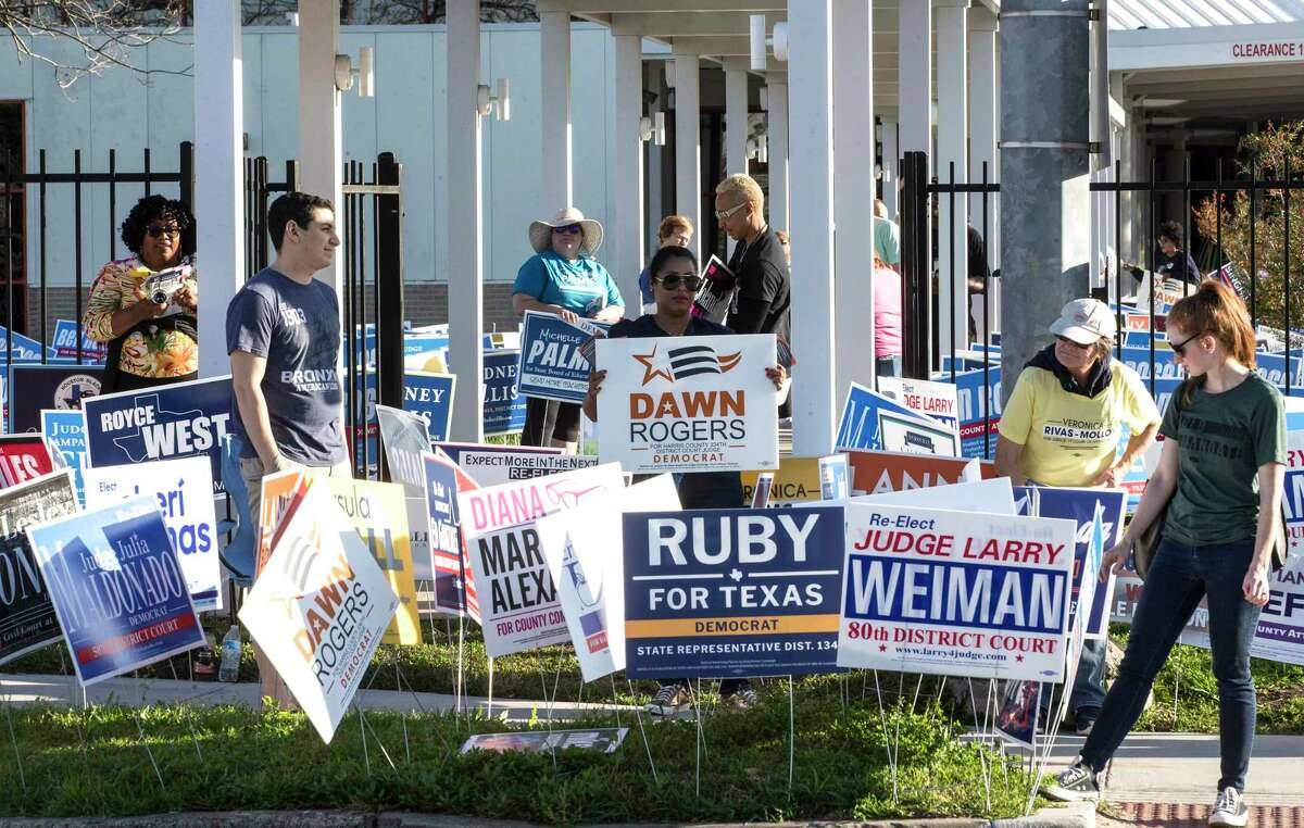 Candidates and their supporters campaign on the final day of early voting before the Super Tuesday primary election Friday, Feb. 28, 2020, at the polling place in the Metropolitan Multi-Service Center, in Houston. As of Thursday, there were more votes cast in the Republican primary than in the Democratic contest.