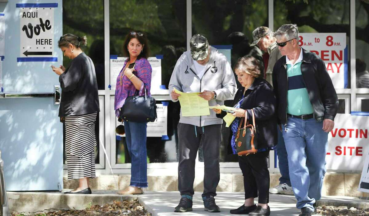 Voters line up outside the Brook Hollow Public Library in San Antonio on the last day of early voting in the 2020 primaries. Experts say the blockbuster turnout is yet another sign of the growing competitiveness of Texas elections and its emerging role as a battleground state.