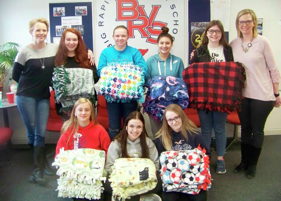 Students from Big Rapids Virtual School donated fleece blankets they made to Angels of Action. The nonprofit organization will distribute the blankets to students in Mecosta County. Back row from left: Kim Easler, of Angels of Action; Taylor Hinkle; Kam Gunn; Alex Hernandez; Megan Ecker and Jayme Smith, of Angels of Action. Front row from left: Andrea Morris, Kaylee Wright and Lily O'Neal. (Courtesy photo)