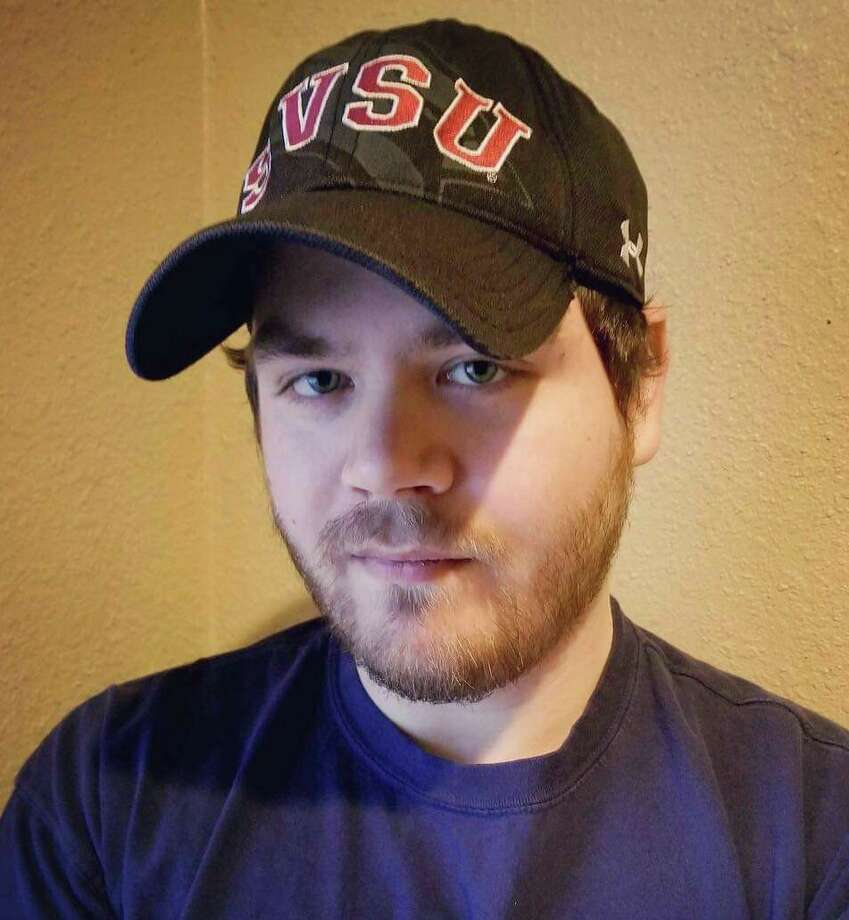 Pictured is James Stahl, a criminal justice major at Saginaw Valley State University and a past president of Press Start, an SVSU student organization that hosts a variety of video game-centric events. (Photo provided)