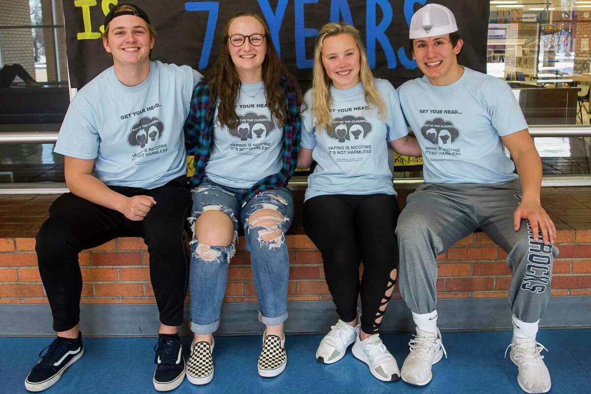 From left, Midland High students Ryan Kreusch, Taylor Sanborn, Marlee Bone and Chase Mahabir pose for a portrait at the school. The students created a campaign, with input from the Legacy Center and Community Mental Health, against the use of e-cigarettes, or