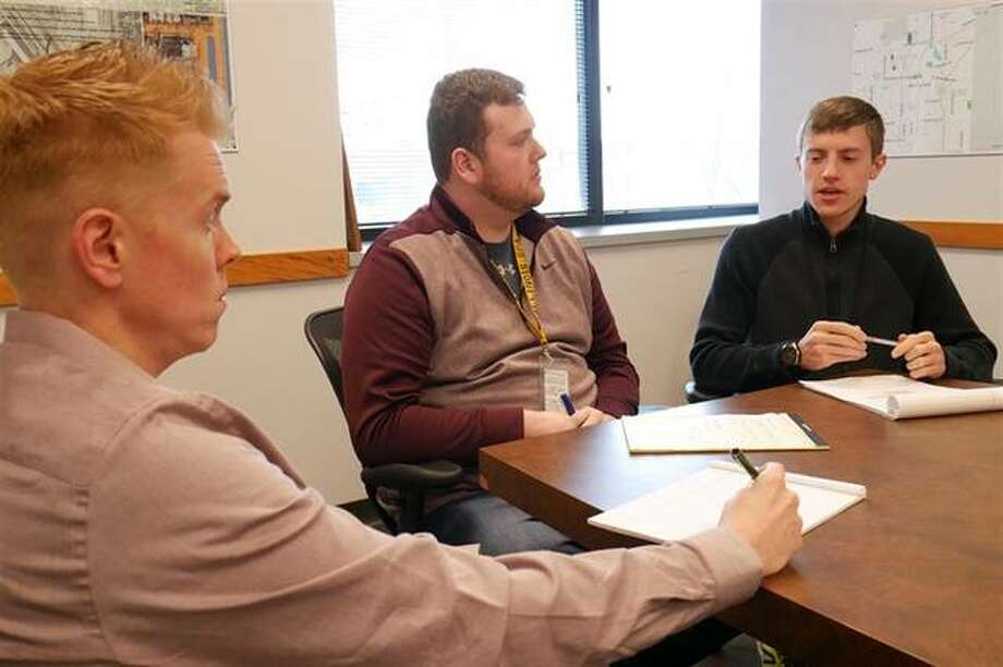 A team at the Illinois Environmental Protection Agency is developing ways to educate people on how to properly dispose of used e-cigarettes and vaping pens. Discussion options are James Jennings (from left), Brock Titlow and Caleb Froidcoeur. Photo: Ben Orner | Capitol News Illinois