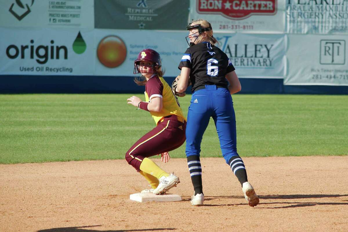 Deer Park's Haidyn Hardcastle (8) is safe at second while Friendswood's Patricia Yarotsky (6) monitors the runner at third Thursday at Friendswood High School.
