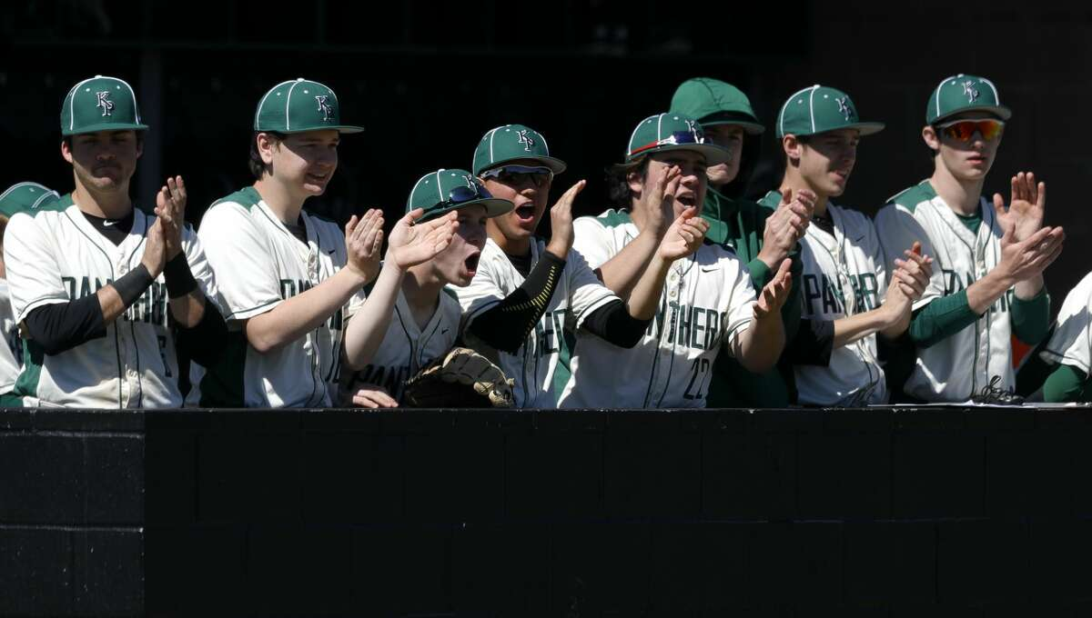 Kingwood Park players watch action during a non-district high school baseball game at Kingwood Park High School, Thursday, Feb. 27, 2020, in Kingwood. The Woodlands defeated Kingwood Park 10-0.