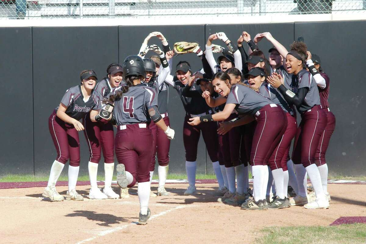 Pearland's Bella Rodriguez (4), being greeted after hitting a home run, returns as the Lady Oilers' catcher this year.