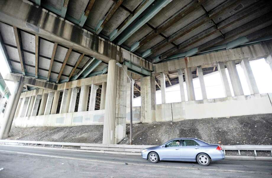 A motorists travels underneath I-95 on South State Street in Stamford on Jan. 14. Part of the governor's CT 2030 tolling plan was to spend upwards of $20 million renovating a stretch of I-95 in Stamford that travels over Metro-North tracks. Photo: Matthew Brown / Hearst Connecticut Media / Stamford Advocate