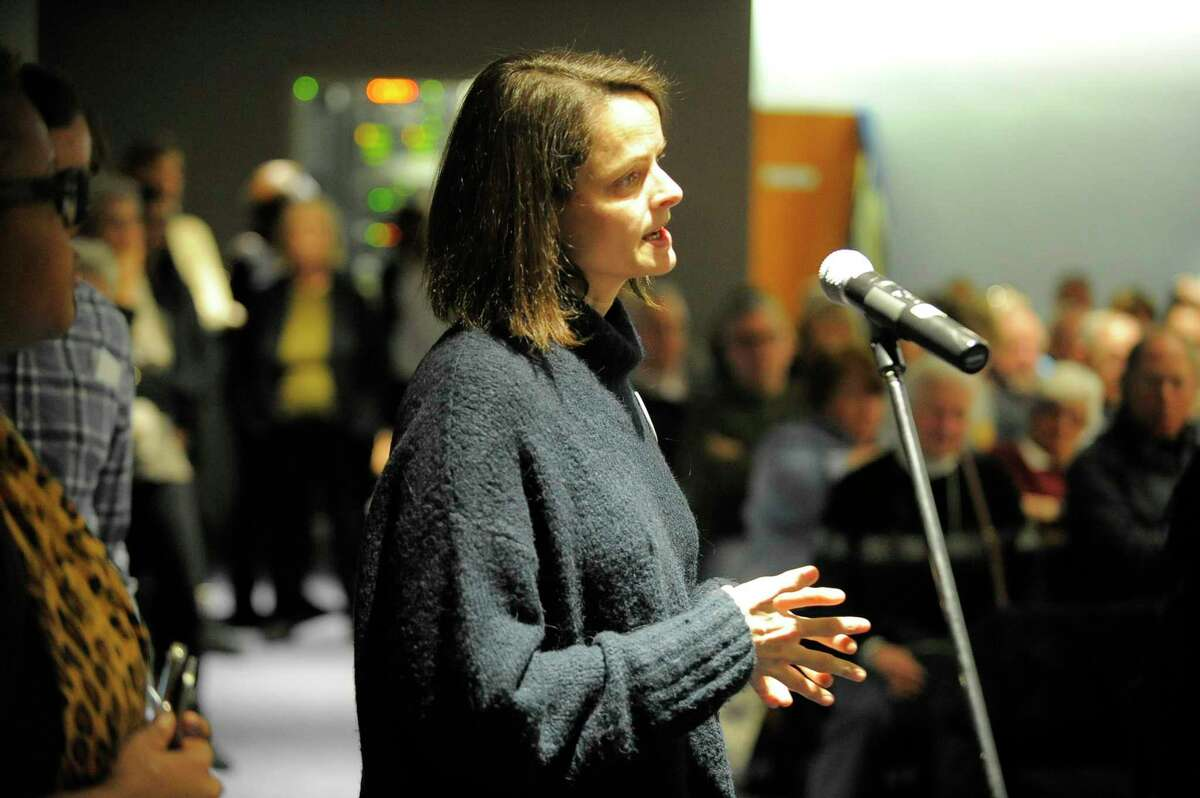 Wendy Skratt of Stamford, addresses U.S. Rep. Jim Himes, D-Conn, during a town hall meeting at UConn Stamford General Re Auditorium in Stamford, Conn. on March 4, 2017.