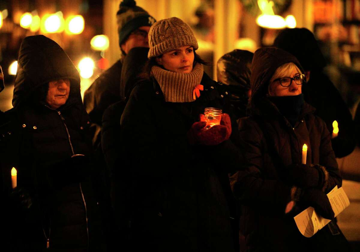 Wendy Skratt, a member of The ENOUGH Campaign stands with other attendees during the fourth annual Stamford Vigil of Hope to End Gun Violence in front of Ferguson Library in Stamford on Dec. 10, 2016.