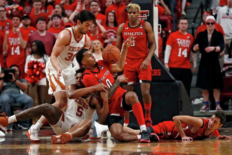Texas' Royce Hamm Jr. (5) and Texas Tech's Kyler Edwards (0) fight for control of the ball during the second half of an NCAA college basketball game Saturday, Feb. 29, 2020, in Lubbock, Texas. (AP Photo/Brad Tollefson) Photo: Brad Tollefson, Associated Press / Copyright 2020 The Associated Press. All rights reserved.