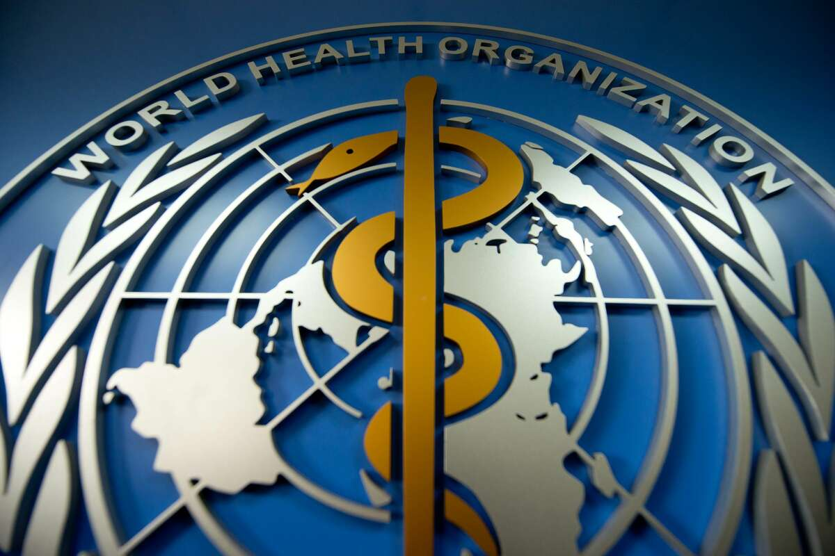 A World Health Organisation (WHO) logo is displayed at their office in Beijing. (Photo by ED JONES/AFP via Getty Images)