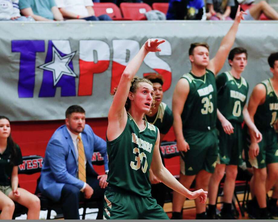 The Woodlands Christian Academy guard Luke Mansfield (30) watches his 3-pointer hit during the third quarter of the TAPPS Class 4A high school basketball championship at West High School, Saturday, Feb. 29, 2020, in West. Photo: Jason Fochtman, Staff Photographer / Houston Chronicle  © 2020