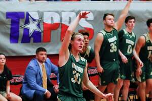 The Woodlands Christian Academy guard Luke Mansfield (30) watches his 3-pointer hit during the third quarter of the TAPPS Class 4A high school basketball championship at West High School, Saturday, Feb. 29, 2020, in West.