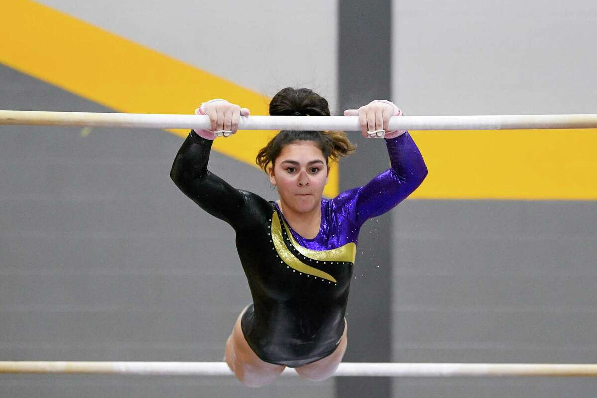 Westhill's Hannah Chuckas performs on the uneven bars during the Class L championship.