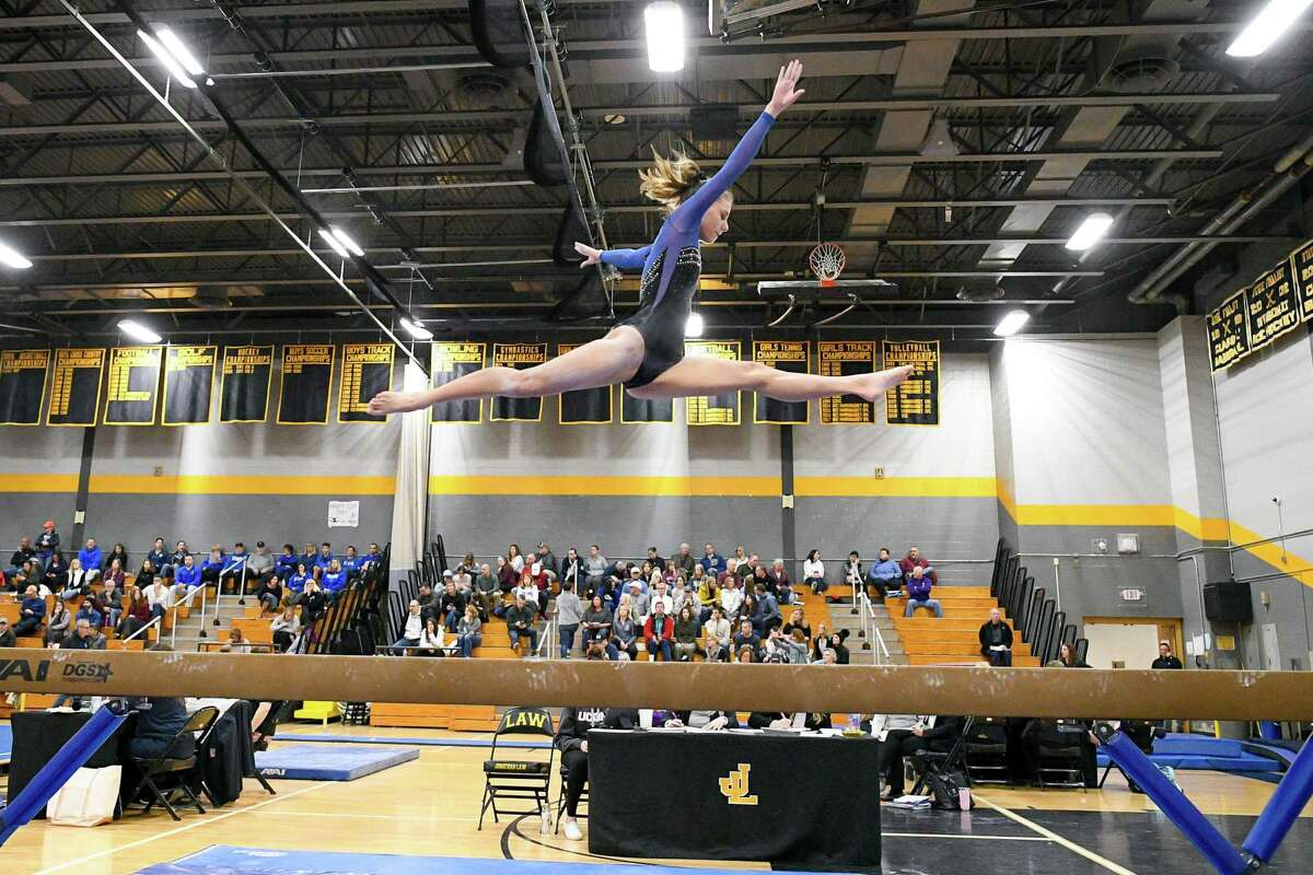 Fairfield Ludlowe's Isabella Factora performs on the balance beam during the CIAC Class L Gymnastics Championship at Jonathan Law, Saturday, February 29, 2020,