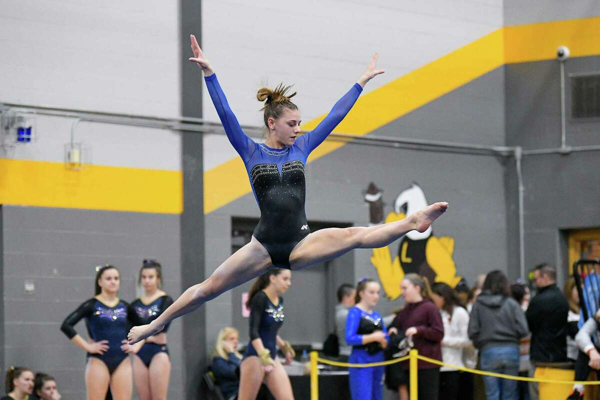 Fairfield Ludlowe's Ava Mancini competes in the floor exercise during the Class L championship.