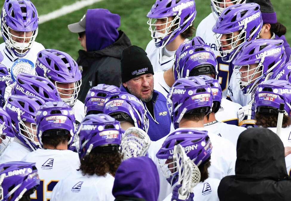University at Albany's head coach Scott Marr instructs his payers against Harvard during an NCAA lacrosse game Saturday, Feb. 29, 2020, in Albany, N.Y.,