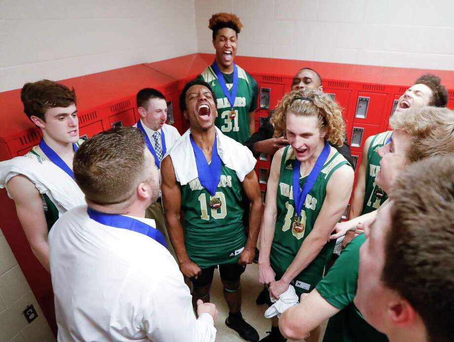 The Woodlands Christian Academy celebrates after winning their second title in three years with a 68-50 victory over Colleyville Covenant Christian during the TAPPS Class 4A high school basketball championship at West High School, Saturday, Feb. 29, 2020, in West. Photo: Jason Fochtman, Staff Photographer / Houston Chronicle © 2020